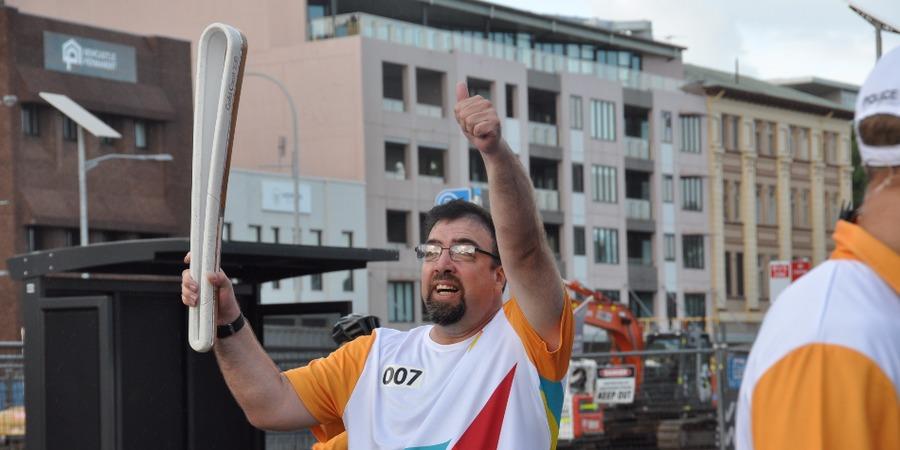 Michael carries Commonwealth Games relay baton